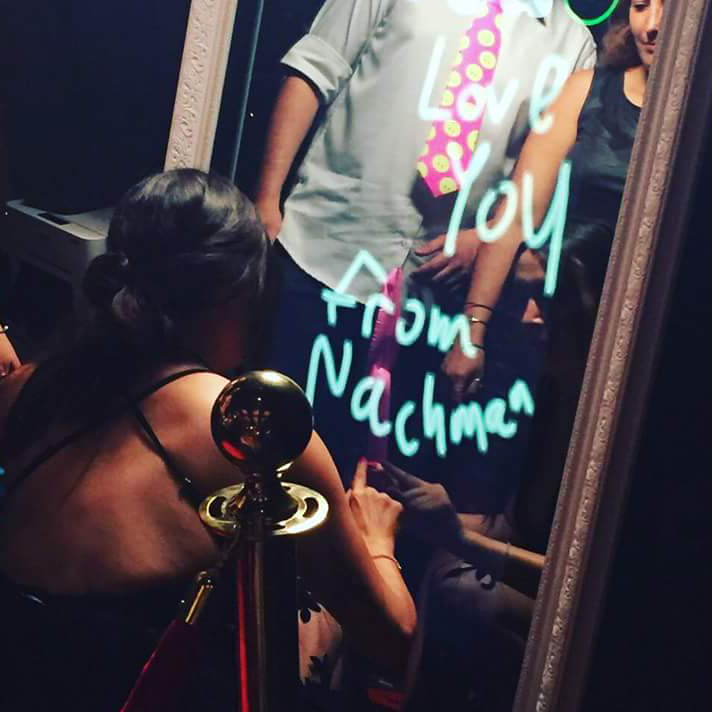 Drawing on a magic mirror photo booth